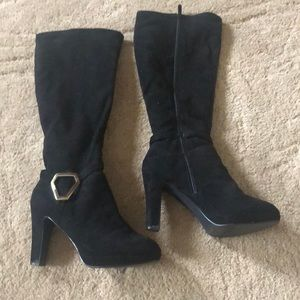 Black heel boots with gold buckle